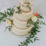 semi naked wedding cake with flowers